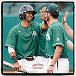 Jason Matthews (11) of the University of South Carolina Upstate Spartans, left, is greeted after scoring a run in a game against the Presbyterian College Blue Hose on Tuesday, March 23, 2021, at Cleveland S. Harley Park in Spartanburg, South Carolina. (Tom Priddy/Four Seam Images)
