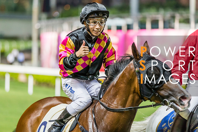 Jockey #9 Matthew Poon Ming-fai riding Le Pegase celebrates after winning the race 1 during Hong Kong Racing at Happy Valley Racecourse on on September 05, 2018 in Hong Kong, Hong Kong. Photo by Yu Chun Christopher Wong / Power Sport Images