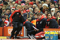 Liverpool Manager Jurgen Klopp looks thoughtful as he watches the match whilst sitting on the advertising hoardings during the Barclays Premier League Match between Liverpool and Swansea City played at Anfield, Liverpool on 29th November 2015