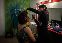 Make up artist takes care of Ali Saleem to look like a woman's hairstyle.