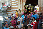 The Dussehra Festival is held in October or early November each year. At this time  Raghunathji (Lord Rama), the presiding Deity of the Kullu Valley, is brought from the Raghunath Temple to Dhalpur Maidan in Kullu. There are around 360 village devtas (gods) and they are carried down from each village to Kullu to pay homage to Lord Raghunathji and to attend the assembly of the gods.The festival celebrates the victory of good over evil, when Lord Rama defeated Ravana the demon king of Lanka. Here the local residents are in the Vashisht temple precinct waiting to accompany the murti of Vashisht who was one of the Saptarishis (seven great sages) and guru (spiritual master) of Lord Rama,to join the other gods in Kullu for the celebrations. Vashisht, Himachal Pradesh, India.