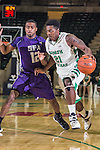 Stephen F. Austin Lumberjacks guard Dallas Cameron (12) and North Texas Mean Green guard T.J. Taylor (21) in action during the game between the Stephen F. Austin Lumberjacks and the North Texas Mean Green at the Super Pit arena in Denton, Texas. SFA defeats UNT 87 to 53.