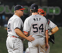 Sept. 17, 2009: Pitching coach Bob Milacki of the Lakewood BloeClaws talks with pitcher Trevor May and catcher Travis D'Arnaud in Game 3 of the South Atlantic League Championship Series between the Greenville Drive and the BlueClaws Sept. 17, 2009, at Fluor Field at the West End in Greenville, S.C.  Photo by: Tom Priddy/Four Seam Images