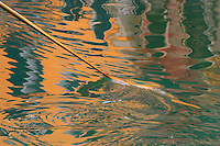 Soft light off reflected buildings as a gondola paddles through the Grande Canal, Venice.