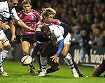 Jamie Robinson tackles Andrew Higgins. Cardiff Blues V Bath, EDF Energy Cup. © Ian Cook IJC Photography iancook@ijcphotography.co.uk www.ijcphotography.co.uk