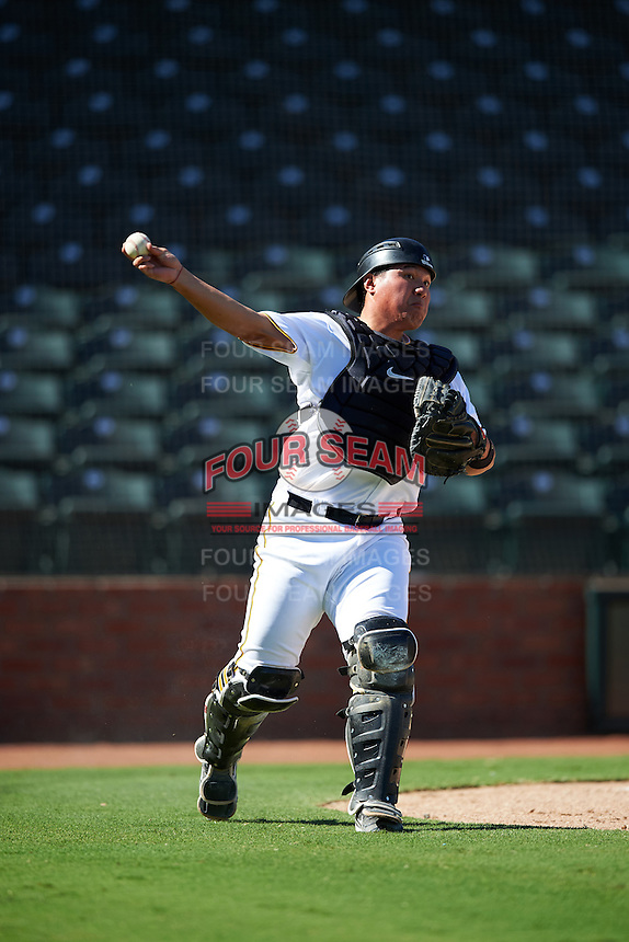Surprise Saguaros Jin-De Jhang (77), of the Pittsburgh Pirates organization, throws to first base to complete the strikeout during a game against the Glendale Desert Dogs on October 22, 2016 at Surprise Stadium in Surprise, Arizona.  Surprise defeated Glendale 10-8.  (Mike Janes/Four Seam Images)