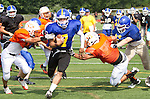 WATERTOWN, CT- 25 AUGUST 2012 082512JW03- Gilbert-Northwestern football player Tony Ortiz Jr. runs the ball against Watertown defenders during a scrimmage Saturday morning at Watertown..Jonathan Wilcox Republican American..