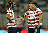 MEXICO CITY, MEXICO - AUGUST 15, 2012:  Kyle Beckerman (5), Graham Zusi (8) and Herculez Gomez (9) of the USA MNT discuss a free kick against  Mexico during an international friendly match at Azteca Stadium, in Mexico City, Mexico on August 15. USA won 1-0.