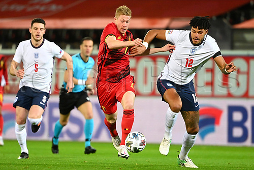 15th November 2020; Leuven, Belgium;  Kevin De Bruyne forward of Belgium battles for the ball with Tyrone Mings defender of England during the UEFA Nations League match group stage final tournament - League A - Group 2 between Belgium and England
