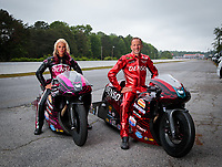 May 3, 2019; Commerce, GA, USA; NHRA pro stock motorcycle rider Angie Smith (left) and husband Matt Smith pose for a portrait prior to qualifying for the Southern Nationals at Atlanta Dragway. Mandatory Credit: Mark J. Rebilas-USA TODAY Sports