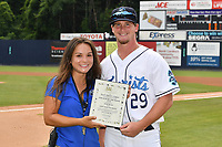 Asheville Tourists pitcher Nick Bush (29) receives pitcher of the week award before a game against the Lakewood BlueClaws at McCormick Field on August 4, 2019 in Asheville, North Carolina. The Tourists defeated the BlueClaws 13-6. (Tony Farlow/Four Seam Images)