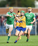 Gary Cooney of Clare in action against Seamus Flanagan and Brian Ryan of Limerick during their Munster U-21 hurling quarter final at Cusack park. Photograph by John Kelly.