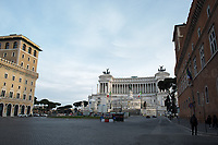 """Piazza Venezia.<br /> <br /> Rome, 12/03/2020. Documenting Rome under the Italian Government lockdown for the Outbreak of the Coronavirus (SARS-CoV-2 - COVID-19) in Italy. On the evening of the 11 March 2020, the Italian Prime Minister, Giuseppe Conte, signed the March 11th Decree Law """"Step 4 Consolidation of 1 single Protection Zone for the entire national territory"""" (1.). The further urgent measures were taken """"in order to counter and contain the spread of the COVID-19 virus"""" on the same day when the WHO (World Health Organization, OMS in Italian) declared the coronavirus COVID-19 as a pandemic (2.).<br /> ISTAT (Italian Institute of Statistics) estimates that in Italy there are 50,724 homeless people. In Rome, around 20,000 people in fragile condition have asked for support. Moreover, there are 40,000 people who live in a state of housing emergency in Rome's municipality.<br /> March 11th Decree Law (1.): «[…] Retail commercial activities are suspended, with the exception of the food and basic necessities activities […] Newsagents, tobacconists, pharmacies and parapharmacies remain open. In any case, the interpersonal safety distance of one meter must be guaranteed. The activities of catering services (including bars, pubs, restaurants, ice cream shops, patisseries) are suspended […] Banking, financial and insurance services as well as the agricultural, livestock and agri-food processing sector, including the supply chains that supply goods and services, are guaranteed, […] The President of the Region can arrange the programming of the service provided by local public transport companies […]».<br /> Updates: on the 12.03.20 (6:00PM) in Italy there 14.955 positive cases; 1,439 patients have recovered; 1,266 died.<br /> <br /> Footnotes & Links:<br /> Info about COVID-19 in Italy: http://bit.do/fzRVu (ITA) - http://bit.do/fzRV5 (ENG)<br /> 1. March 11th Decree Law http://bit.do/fzREX (ITA) - http://bit.do/fzRFz (ENG)<br /> 2. http://bit.do/fzRKm"""