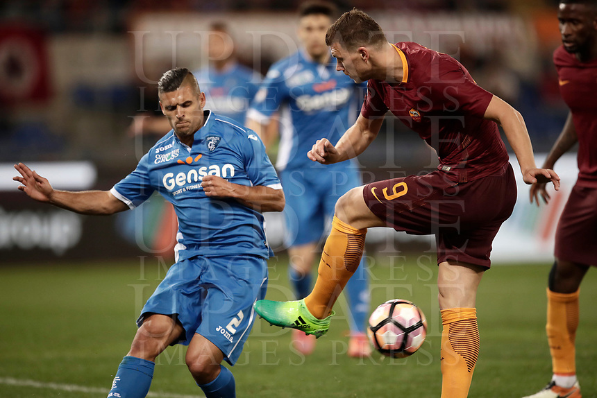 Calcio, Serie A: Roma, stadio Olimpico, 1 aprile, 2017.<br /> Roma's Edin Dzeko (r) in action with Empoli's Vincent Laurini during the Italian Serie A football match between Roma and Empoli at Olimpico stadium, April 1, 2017<br /> UPDATE IMAGES PRESS/Isabella Bonotto