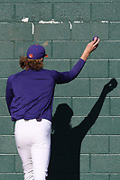 Pitcher Holt Jones (45) of the Clemson Tigers warms up by throwing a ball against the bullpen wall before a game against the Stony Brook Seawolves on Friday, February 21, 2020, at Doug Kingsmore Stadium in Clemson, South Carolina. Clemson won, 2-0. (Tom Priddy/Four Seam Images)