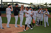 Jupiter Hammerheads left fielder Stone Garrett (26) high fives with his teammates after a game against the Fort Myers Miracle on April 9, 2017 at CenturyLink Sports Complex in Fort Myers, Florida.  Jupiter defeated Fort Myers 3-2.  (Mike Janes/Four Seam Images)