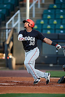 Chattanooga Lookouts first baseman Jonathan Rodriguez (30) follows through on a swing during a game against the Jackson Generals on April 27, 2017 at The Ballpark at Jackson in Jackson, Tennessee.  Chattanooga defeated Jackson 5-4.  (Mike Janes/Four Seam Images)