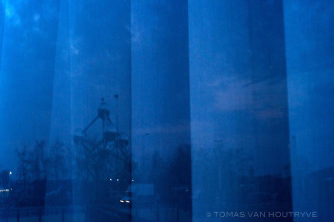The Atomium is seen reflected in a window in Brussels, Belgium on March 25, 2013.