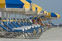 Colorful beach chairs await sunbathing tourists on Dayton Beach,Florida. Atlantic Ocean (do)(no MR)