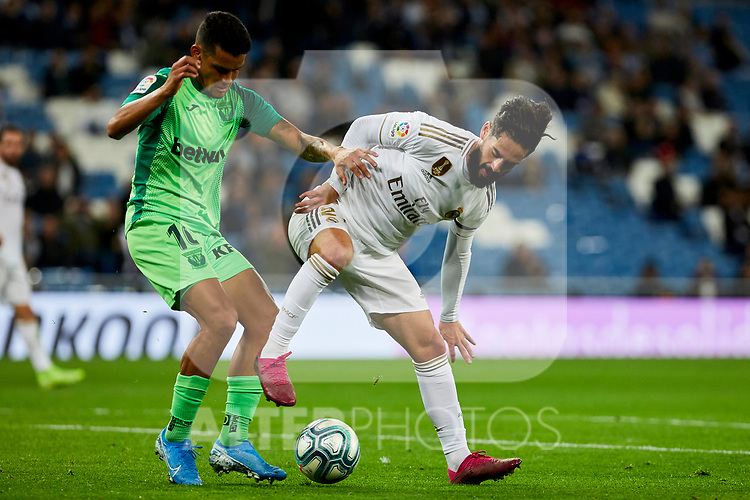 Francisco Alarcon 'Isco' of Real Madrid and Roberto Rosales of CD Leganes during La Liga match between Real Madrid and CD Leganes at Santiago Bernabeu Stadium in Madrid, Spain. October 30, 2019. (ALTERPHOTOS/A. Perez Meca)