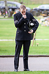 © Joel Goodman - 07973 332324 . 17/03/2012 . Staffordshire , UK . A police officer in dress uniform wipes a tear from his eye and stands alone outside the crematorium , listening to the service as it is relayed on loudspeaker . The funeral of former police officer David Rathband , at Stafford Crematorium . Rathband was found dead at his home in Blyth on 29th February 2012 . He was shot and blinded by killer Raoul Moat whilst he was on duty in the early hours of 4th July 2010 and went on to campaign for the Blue Lamp Foundation , which supports emergency staff injured in the line of duty , but he was reported to have never overcome the psychological impact of his injuries . Photo credit : Joel Goodman