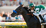 Lady of Shamrock with Mike Smith (left) defeats Stormy Lucy and Martin Pedroza to win the Del Mar Oaks at Del Mar Race Course in Del Mar, California on August 18, 2012.