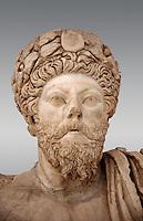 Roman sculpture of the Emperor Marcus Aurelius, excavated from Bulla Regia Theatre, sculpted circa late second century. The Bardo National Museum, Tunis.   Against a grey background.