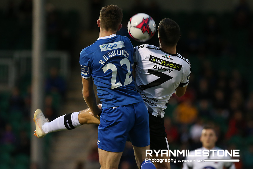 Michael Duffy of Dundalk in action against Karl O'Sullivan of Limerick during the SSE Airtricity League Premier Division game between Limerick FC and Dundalk FC on Friday 31st August 2018 at Markets Field, Limerick. Photo By Michael P Ryan