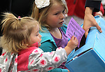 Emma Baroni, 20 months, and her sister Madison, 5, turn in their tickets for Storytime at the Carson City Library, in Carson City, Nev. on Thursday, Nov. 29, 2012..Photo by Cathleen Allison