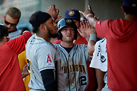 Burlington Bees Justin Jones (12) high fives teammates during a Midwest League game against the Lansing Lugnuts on July 18, 2019 at Cooley Law School Stadium in Lansing, Michigan.  Lansing defeated Burlington 5-4.  (Mike Janes/Four Seam Images)