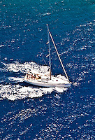 2 August 2009: An aerial view of a sailboat under power outside the Caribbean town of Willemstad, on the island of Curacao, in the Netherlands Antilles. Curaçao is known for tourism, scuba diving, and technologically advanced business districts. Mandatory Photo Credit: Ed Wolfstein Photo