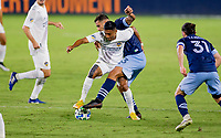 CARSON, CA - OCTOBER 18: Ali Adnan #53 of the Vancouver Whitecaps battles with Julian Araujo #22 of the Los Angeles Galaxy for a ball during a game between Vancouver Whitecaps and Los Angeles Galaxy at Dignity Heath Sports Park on October 18, 2020 in Carson, California.