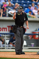 Umpire James Rackley makes a call during the second game of a double header between the Biloxi Shuckers and Pensacola Blue Wahoos on April 26, 2015 at Pensacola Bayfront Stadium in Pensacola, Florida.  Pensacola defeated Biloxi 2-1.  (Mike Janes/Four Seam Images)