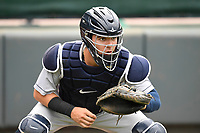 Catcher Donny Sands (15) of the Charleston RiverDogs warms up prior to a game against the Greenville Drive on Thursday, July 27, 2017, at Fluor Field at the West End in Greenville, South Carolina. Charleston won, 5-2. (Tom Priddy/Four Seam Images)