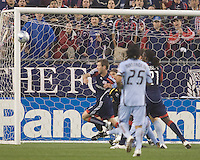 New England Revolution midfielder Steve Ralston (14) gets taken down and is awarded a penalty kick. The New England Revolution tied the Colorado Rapids, 1-1, at Gillette Stadium on May 16, 2009.