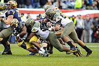 Philadelphia, PA - December 14, 2019:   Navy Midshipmen fullback Jamale Carothers (34) gets tackled by several Army Black Knights defenders during the 120th game between Army vs Navy at Lincoln Financial Field in Philadelphia, PA. (Photo by Elliott Brown/Media Images International)
