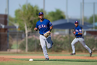 Texas Rangers third baseman Tyler Ratliff (32) watches his throw to first base during an Instructional League game against the San Diego Padres on September 20, 2017 at Peoria Sports Complex in Peoria, Arizona. (Zachary Lucy/Four Seam Images)