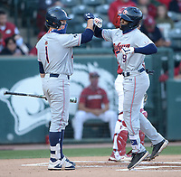 Auburn shortstop Ryan Bliss (right) is congratulated at the plate Friday, April 2, 2021, by left fielder Judd Ward after hitting a solo home run during the first inning of play against Arkansas at Baum-Walker Stadium in Fayetteville. Visit nwaonline.com/210403Daily/ for today's photo gallery. <br /> (NWA Democrat-Gazette/Andy Shupe)