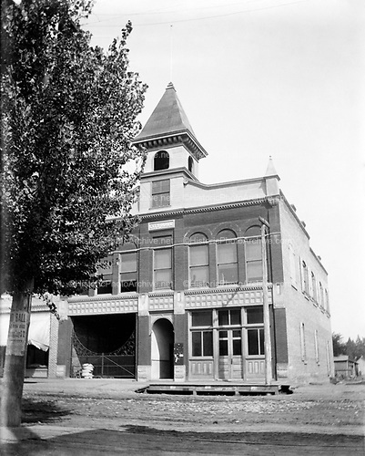 "0405-D04. ""City Hall"" and Fire House, Newberg, Oregon, ca. 1913. The building looks like it is about to be demolished. Newberg built a new City Hall in 1914."