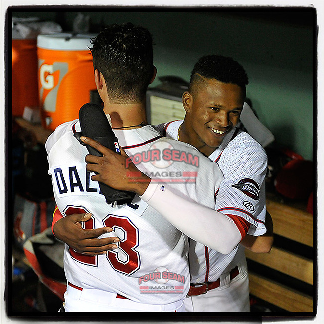 Third baseman Bobby Dalbec (23) of the Greenville Drive is embraced by Yoan Aybar after hitting a three-run home run in the eighth inning of Game 3 of the South Atlantic League Southern Division Playoff against the Charleston RiverDogs on Saturday, September 9, 2017, at Fluor Field at the West End in Greenville, South Carolina. Greenville won, 5-0, winning the division championship two games to one. (Tom Priddy/Four Seam Images)
