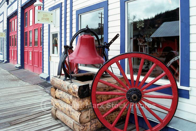 Dawson City, YT, Yukon Territory, Canada - Wagon Wheel and Bell outside Old Firehall