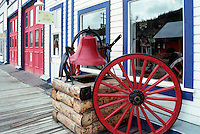 Dawson City, YT, Yukon Territory, Canada - Wagon Wheel and Bell outside Old Firehall