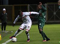 BOGOTA - COLOMBIA - 15 - 09 - 2017: Neider Barona(Der.) jugador de La Equidad disputa el balón con Jhonier Viveros (Izq.) jugador de Cortuluá, durante partido entre La Equidad y Cortuluá,  por la fecha 12 de la Liga Aguila II-2017, jugado en el estadio Metropolitano de Techo de la ciudad de Bogota. / Neider Barona (R) player of La Equidad vies for the ball with Jhonier Viveros (L) player of Cortulua, during a match between La Equidad and Cortulua, for the  date 12nd of the Liga Aguila II-2017 at the Metropolitano de Techo Stadium in Bogota city, Photo: VizzorImage  /Felipe Caicedo / Staff.