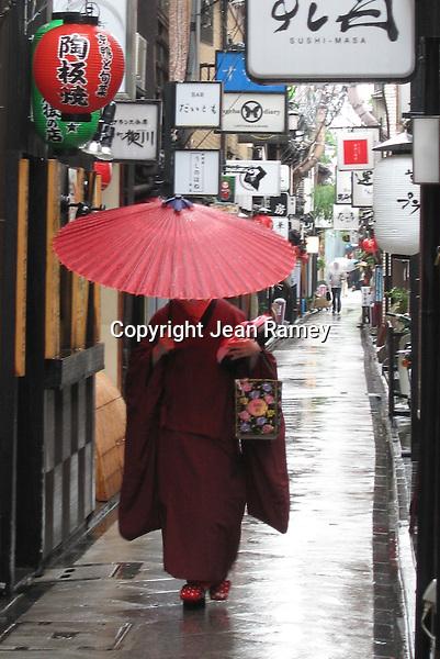 A Geisha and the Red Umbrella - Kyoto