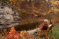 Mat sits on bench with his pet wild turkey (Bugsy) in early fall, Midwest