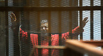 FILE PHOTO: Ousted Egyptian president Mohammed Morsi sits behind bars during his trail as part of the so-called 'Qatar espionage' case, in a court in Cairo on March 21, 2016. Former President Mohamed Morsi died on Monday in court after the conclusion of a trial session in the espionage lawsuit, Egyptian state TV said. Photo by Stranger