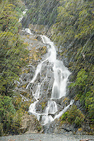 Snowing at Fantail Falls near Haast Pass, Mount Aspiring National Park, Central Otago, UNESCO World Heritage Area, New Zealand, NZ