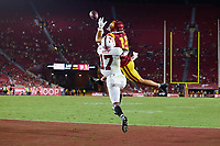 LOS ANGELES, CA - SEPTEMBER 11: Drake London #15 of the USC Trojans makes a touchdown reception defended by Kyu Blu Kelly #17 of the Stanford Cardinal during a game between University of Southern California and Stanford Football at Los Angeles Memorial Coliseum on September 11, 2021 in Los Angeles, California.