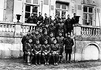 Officers, 129th Field Artillery, at regimental headquarters at Chateau le Chanay near Courcemont, France, March 1919.  Capt. Harry Truman, second row, third from right.  M. Le Chanoine E. Vallee.  (Army)<br /> Exact Date Shot Unknown<br /> NARA FILE #:  111-SC-89677<br /> WAR & CONFLICT BOOK #:  499