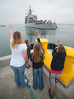 100911-N-7981E-883 .SAN DIEGO (Sept. 11, 2010) Sailors man the rails aboard the guided-missile cruiser USS Cape St. George (CG 71) as family members wave good-bye from the pier. Cape St. George deployed with the Abraham Lincoln Carrier Strike Group as part of an ongoing rotation of forward deployed forces to support maritime security operations around the globe. (U.S. Navy photo by Mass Communication Specialist 2nd Class James R. Evans/Released) .